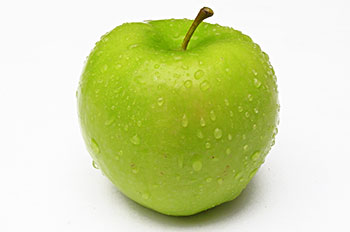 a green apple sprinkled with water