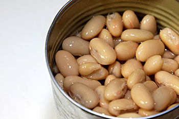 Cannellini beans shown still in their metal can