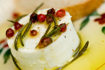 goat cheese drizzled with olive oil - an appetizer