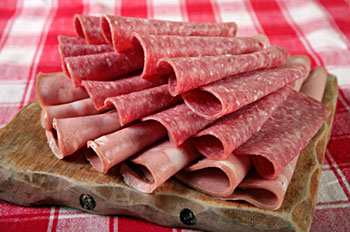 a selection of processed meats (cold cuts)