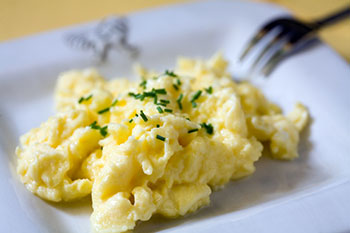 a plate of scrambled eggs