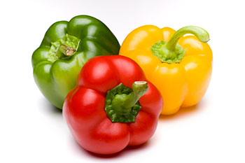 three bell peppers, all different colors: red, yellow, and green