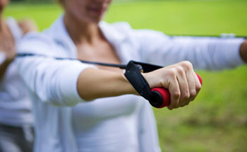 Woman using a resistance band to exercise