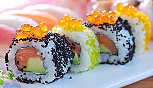 Sushi roll of raw salmon and avocado
