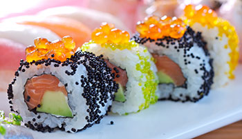 A salmon and avocado sushi roll