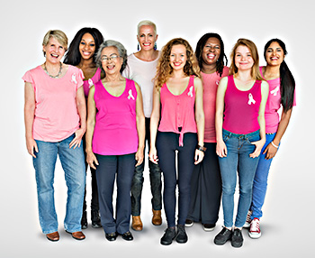 an ethnically- and body-type-diverse group of women wearing pink ribbons