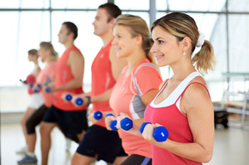 Men and women exercising with hand-held weights