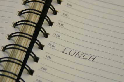 the word 'lunch' written in a daily planner book