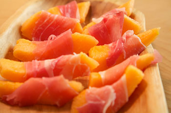 Canteloupe melon slices wrapped with prosciutto
