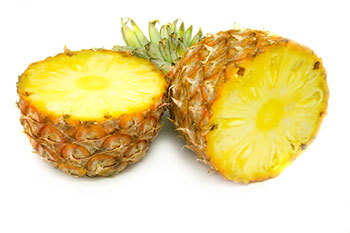 a fresh pineapple, sliced in half horizontally