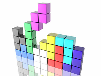 blocks falling together in the style of the computer game Tetris