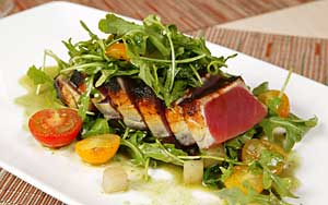 a salad topped with seared tuna