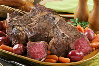 a beef roast with red potatoes and baby carrots