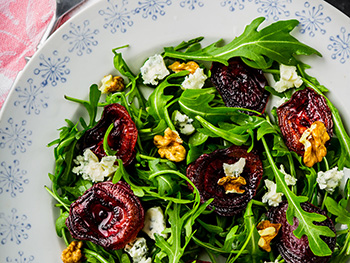 a green salad with roasted beets, arugula, pecans, and blue cheese