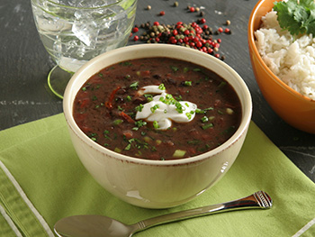 black bean soup garnished with sour cream - click for recipe!