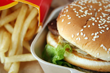 a fast food hamburger meal with french fries