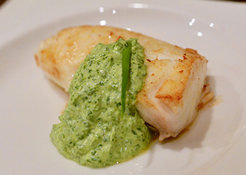 Cilantro Garlic Sauce served on a piece of roasted halibut