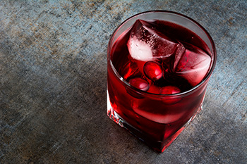 a glass of iced cranberry juice