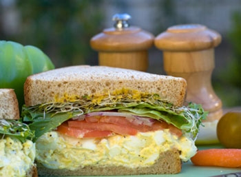an egg salad sandwich on whole wheat bread