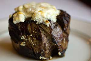 a filet of beef topped with blue cheese - click for the recipe!