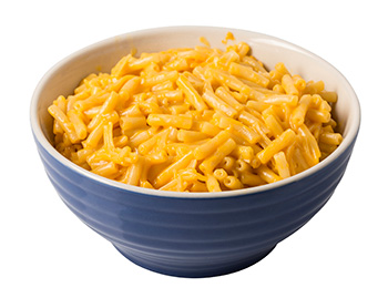a bowl of mac and cheese made from a boxed mix - a highly processed food