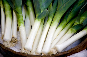 fresh leeks in a wicker basket