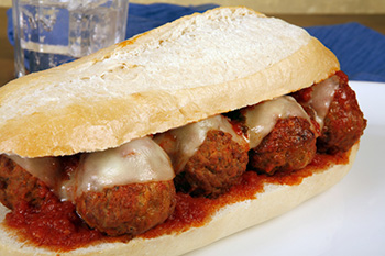 a meatball hoagie made with low-acid tomato sauce