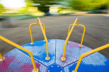 a view from the center of a moving merry-go-round