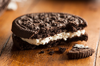 a closeup of an oreo cookie with a bite taken out of it