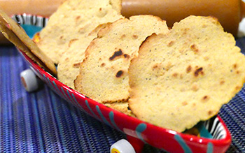 several Papadum in a ceramic basket