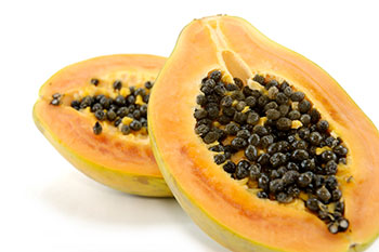 a papaya split in half to reveal the seeds