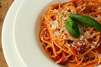 A plate of traditional spaghetti with tomato sauce