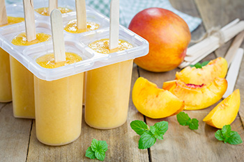 Creamy Peach Yogurt Pops are easy to make at home with a recipe from Dr. Gourmet