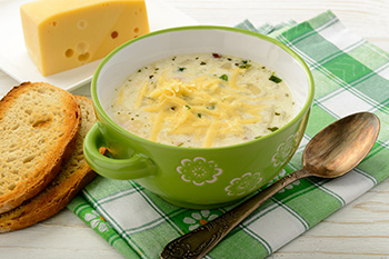 potato soup garnished with cheese and chives