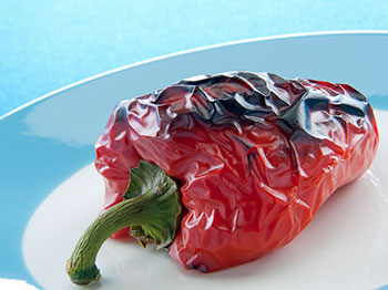 roasted red pepper on a blue plate