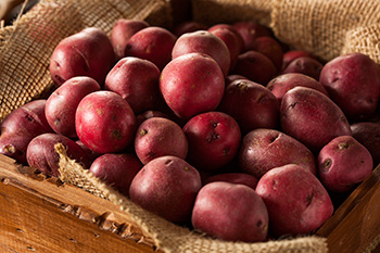 a basket of red potatoes
