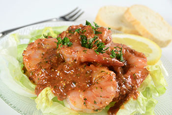 poached shrimp topped with a remoulade sauce - click for recipe
