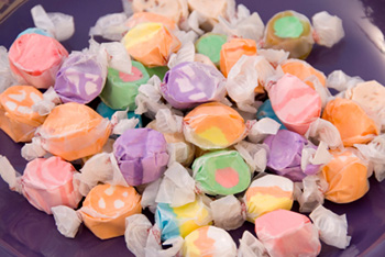 Taffy candies individually wrapped in waxed paper