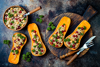 butternut squash stuffed with grains and vegetables