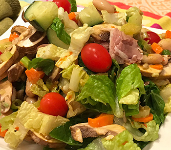 a fresh salad dressed with a vinaigrette using one of the mustards in the Christmas Basket