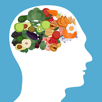 the silhouette of a person's head filled with brain-protective foods