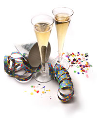 two flutes of champagne and a festive mask for a holiday party